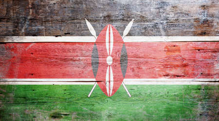 Flag of Kenya painted on grungy wood plank background  photo