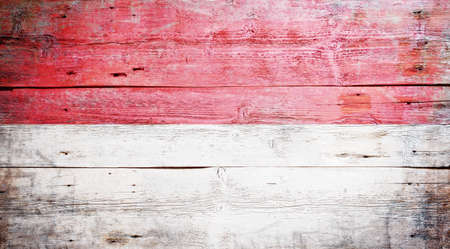 Flag of Indonesia painted on grungy wood plank background  photo
