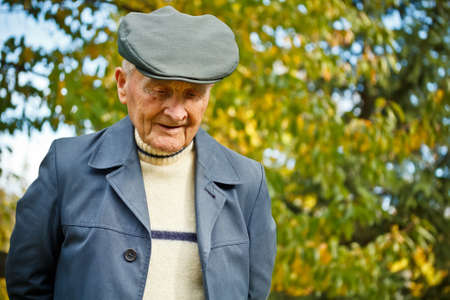 Outdoor portrait of a very old man