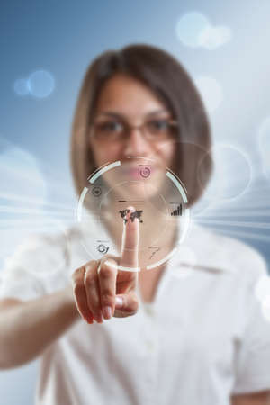 Businesswoman pressing modern buttons on a virtual background  Stock Photo - 16215971
