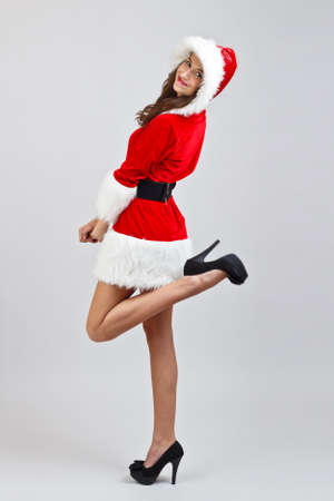 Young woman wearing santa clause costume photo