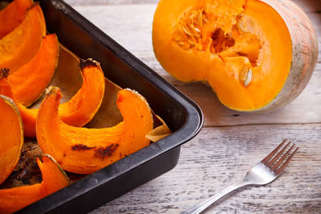 Roast pumpkin sitting on baking parchment photo