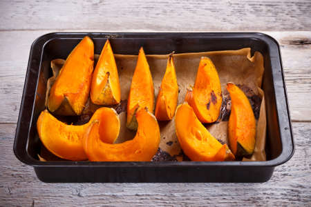 pumpkin seed: Roasted pumpkin on metal plate dish  Stock Photo