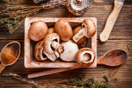 healthful: Fresh brown mushrooms on earthenware