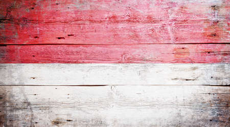 Flag of Indonesia painted on grungy wood plank background  Stock Photo - 16470974