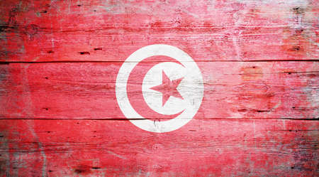 Flag of Tunisia painted on grungy wood plank background Stock Photo - 16470977