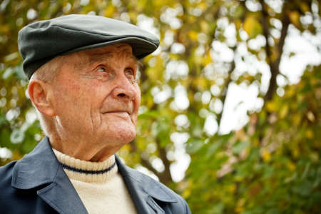 one year old: Elderly man portrait at outdoor shot  Stock Photo
