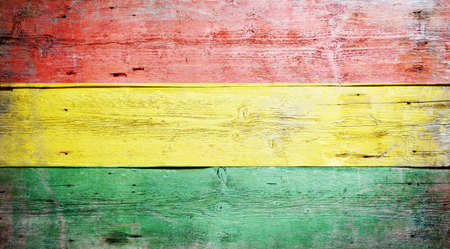Flag of Bolivia painted on grungy wood plank background Stock Photo - 16489248