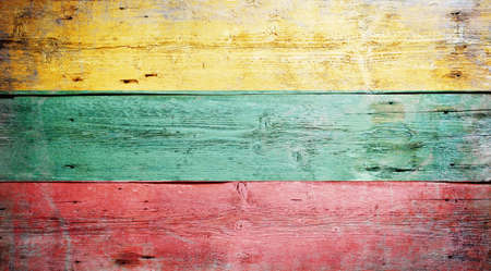 Flag of Lithuania painted on grungy wood plank background  Stock Photo - 16489251