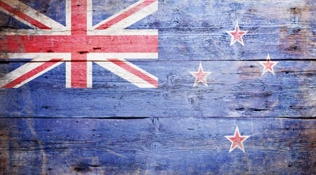 Flag of New Zealand painted on grungy wood plank background Stock Photo - 16489253