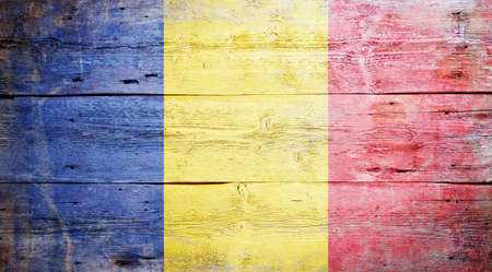 Flag of Romania painted on grungy wood plank background Stock Photo - 16489249