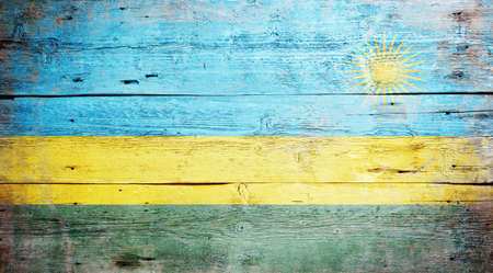Flag of Rwanda painted on grungy wood plank background  Stock Photo - 16489250
