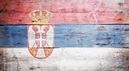 Flag of Serbia painted on grungy wood plank background Stock Photo - 16489246