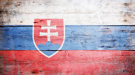 Flag of Slovakia painted on grungy wood plank background  Stock Photo - 16489245