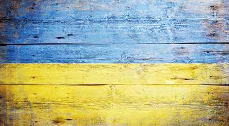 bicolor: Flag of Ukraine painted on grungy wood plank background  Stock Photo
