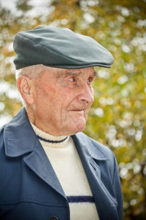 Portrait of an elderly man in the forest  photo