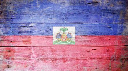 Flag of Haiti painted on grungy wood plank background  Stock Photo - 16571088