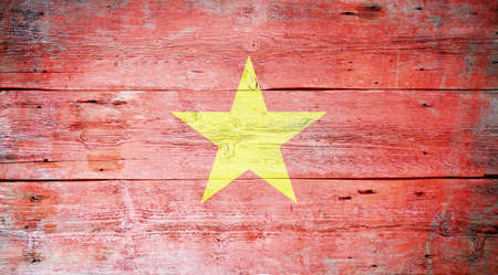 Flag of Vietnam painted on grungy wood plank background  Stock Photo - 16571220