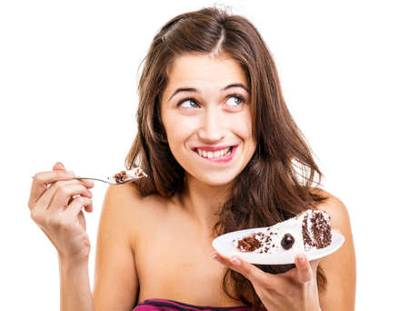 Young woman with slice of cake Stock Photo - 16800376