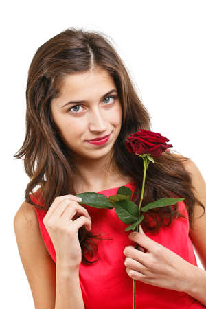 Portrait of pretty young woman with rose  Stock Photo - 16800381