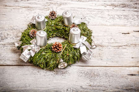 religious event: Advent wreath on wooden background