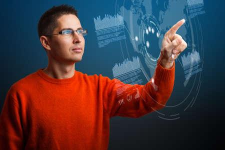 navigating: Young man navigating interface in future