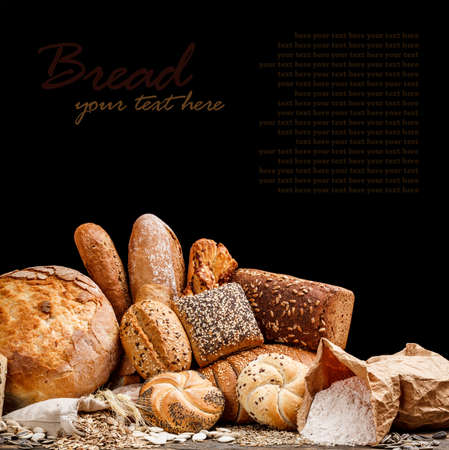 loaf of bread: Group of different types of bread on black background Stock Photo