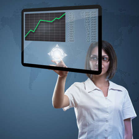 Attractive young woman with  high tech panel  photo