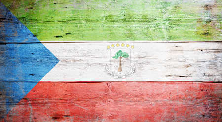 equatorial guinea: Flag of Equatorial Guinea painted on grungy wood plank background