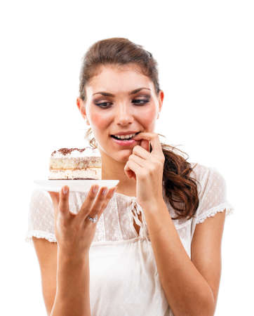 Young beautiful woman with a cake  photo