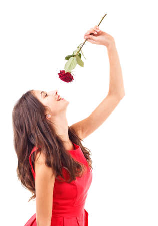 Portrait of happy woman smelling red rose  photo