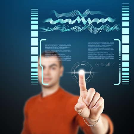 Young man navigating holographic virtual reality interface.  photo