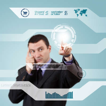 Businessman pressing modern buttons on a virtual background  photo