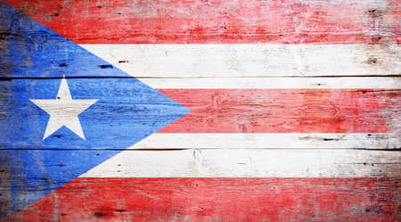 Flags of Puerto Rico painted on grungy wood plank background  photo