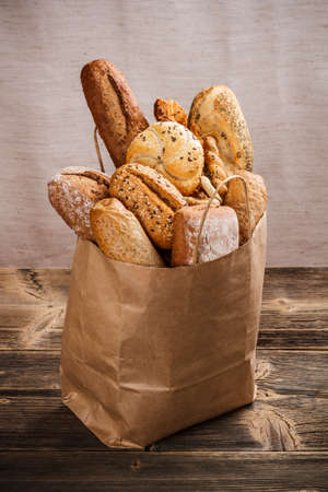 Assortment of baked goods packaged in a paper bag  photo
