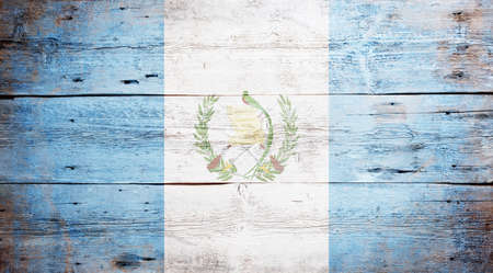 Flag of Guatemala painted on grungy wood plank background  Stock Photo - 17341569