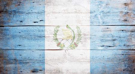 Flag of Guatemala painted on grungy wood plank background Stock Photo - 17341569