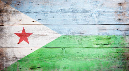 Flag of Djibouti painted on grungy wood plank background  Stock Photo - 17461971