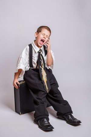 Little boy dressed as businessman  photo