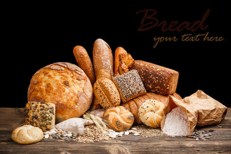 Fresh bread still life on wooden table Stock Photo