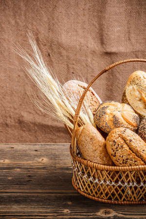 Basket with bread canvas in background Stock Photo - 17462053