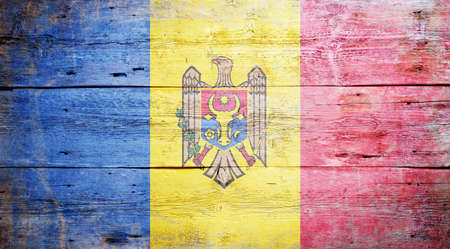 Flag of Moldova painted on grungy wood plank background  Stock Photo - 17462082