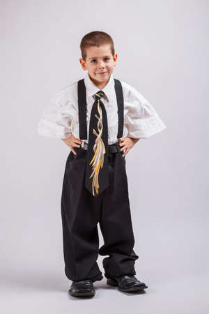 over sized: Little business boy in over sized large suit  Stock Photo