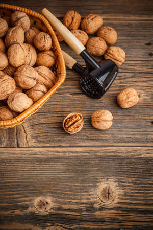 Walnuts on rustic wooden board photo