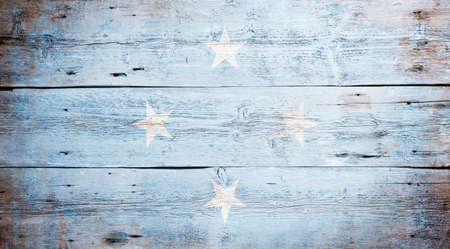 micronesia: Flag of the Federated States of Micronesia painted on grungy wood plank background Stock Photo