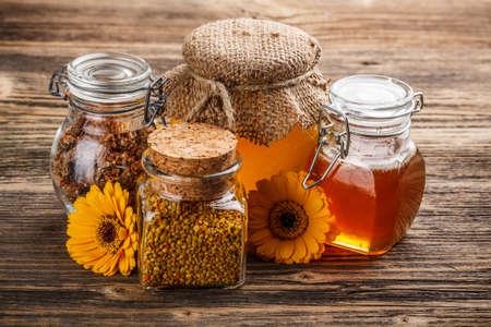 Still life of jars of honey, propolis and pollen