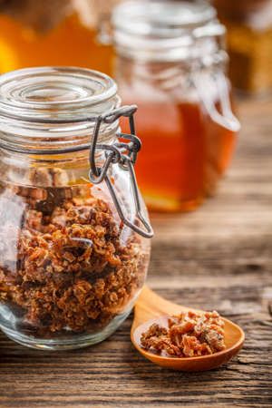 Propolis in glass jar, product of bees Stock Photo