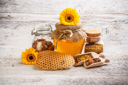 Combs, honey, pollen and propolis decorated with flower Stock Photo - 17653069