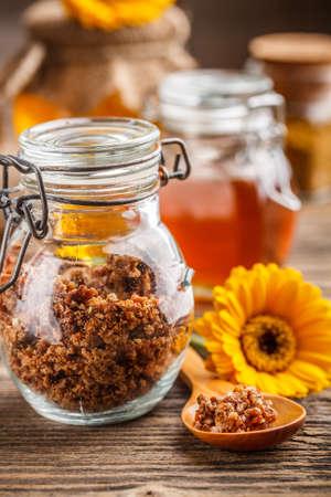 antimicrobial: Propolis granule in glass jar, honey in background