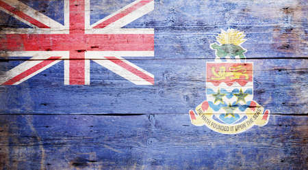 Flag of the Cayman Islands painted on grungy wood plank background Stock Photo - 17653092